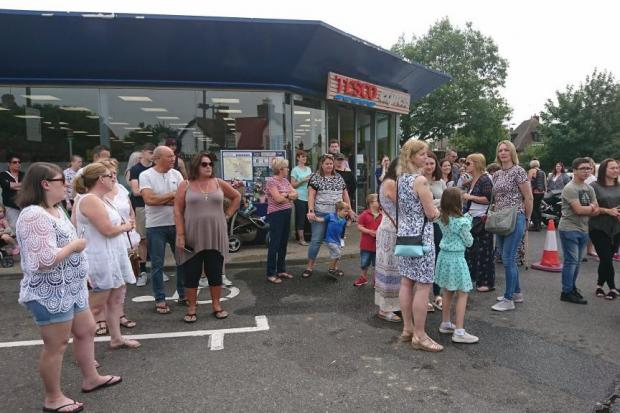 Crowds waiting outside Tesco in Burhnam for Beverley O'Connor's memorial dove release. Photo by Nick Skeens