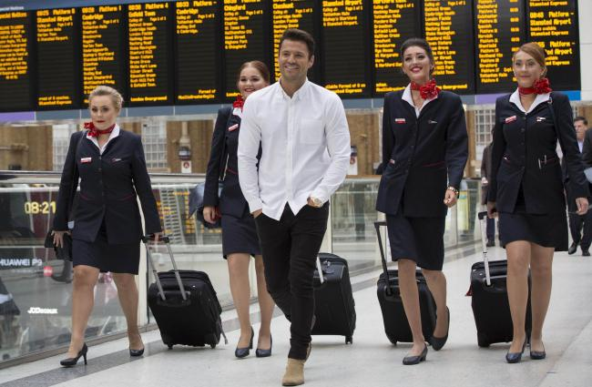 EDITORIAL USE ONLY..Mark Wright is greeted by Jet2.com cabin crew at Liverpool Street station in London, as the airline and Jet2holidays officially launched flights and holidays from London Stansted Airport. PRESS ASSOCIATION Photo. Picture date: Wednesda