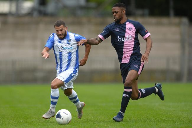 Friendly fire - Colchester United new boy Luke Gambin battles for possession in their 2-0 friendly win over Dulwich Hamlet last night Picture: RICHARD BLAXALL