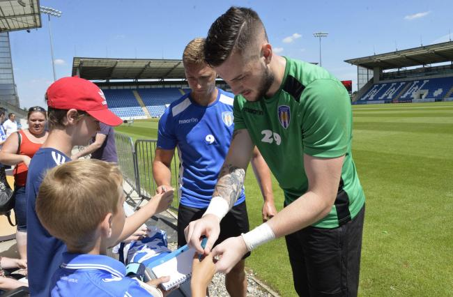 Meet and greet - Colchester United players sign autographs at last summer's Open Day Picture: STEVE BRADING