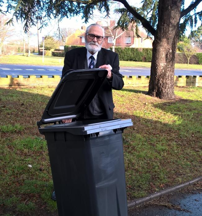 Michael Talbot, Tendring Council's cabinet member for environment, pictured with a sample black wheelie bin.
