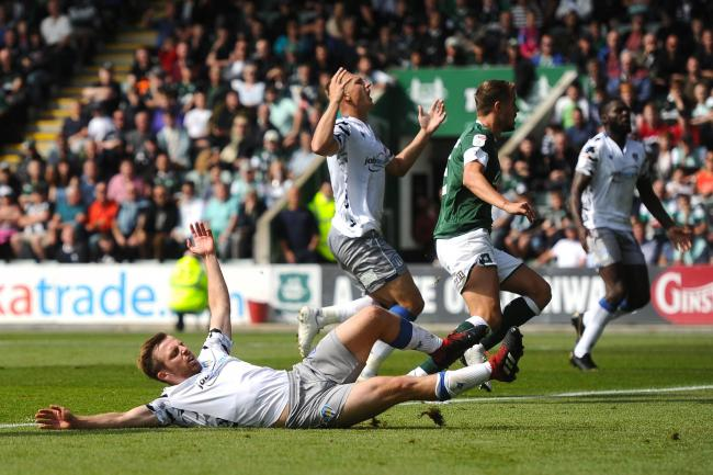 Agonising moment - Tom Lapslie comes inches away from giving Colchester United the lead at Plymouth Argyle, with Luke Norris in the background Picture: RICHARD BLAXALL