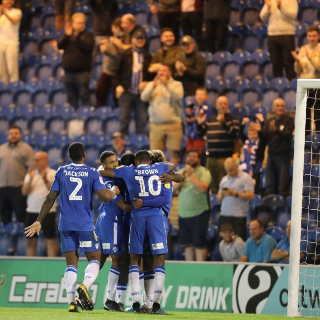 Joy - Colchester United celebrate after scoring their second goal against Swindon Town Picture: STEVE BRADING