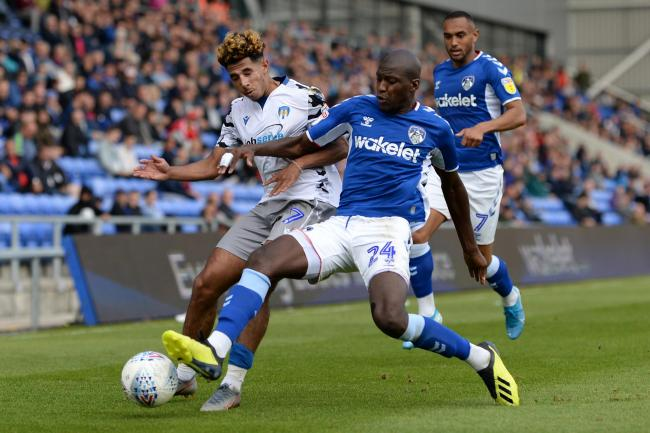 Wing play - Colchester United's Courtney Senior does battle with Mohamed Sylla of Oldham Athletic Picture: RICHARD BLAXALL
