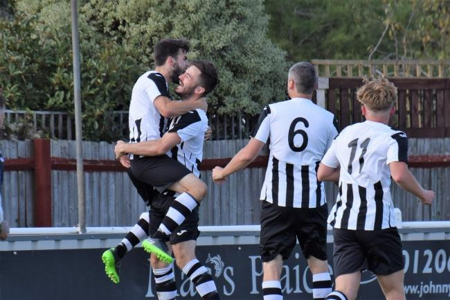 Sam Cripps and Jordan Heath celebrate Harwich's winning goal at Brightlingsea Regent Reserves on Saturday. Picture: Chris Smith
