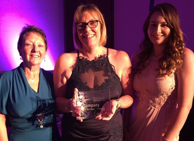 Julie Blanche (centre) with staff members Maggi Paul and Lucy Gray at the awards ceremony in Reading