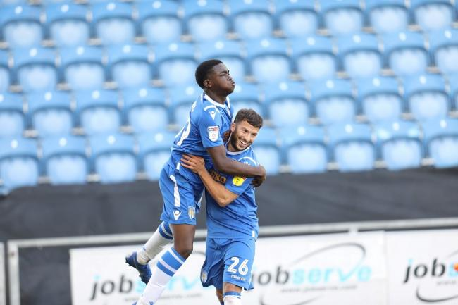 Lift off - Kwame Poku celebrates with team-mate Luke Gambin after scoring in Colchester United's 3-1 win over Stevenage Picture: STEVE BRADING