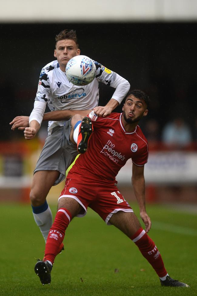 Ryan Clampin of Colchester United does battle with Tarryn Allarakhia of Crawley Town - Crawley Town vs. Colchester United - Sky Bet League Two - People's Pension Stadium, Crawley - 12/10/2019 - Photo by: Richard Blaxall.