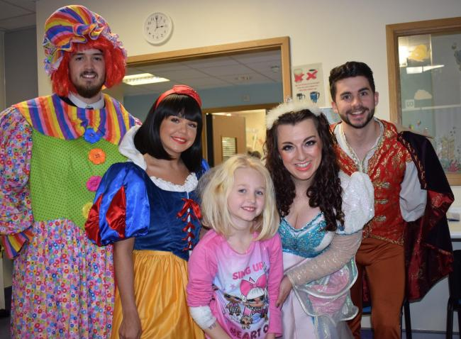 FESTIVE FUN: panto stars put smiles on the faces of young patients at Colchester General Hospital