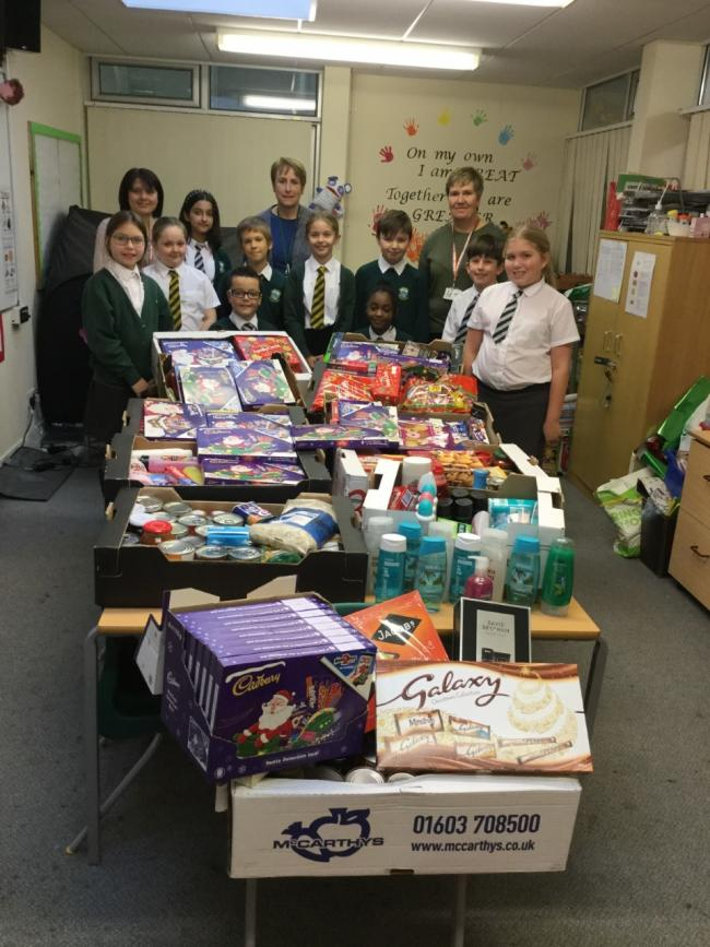 Generous - Friars Grove Primary School pupils with Rachel Hynes (left) and Kim Sherwood (right) and headteacher, Susan Shipp