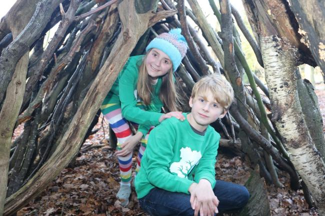 Exploring - Ciara, 13, and Toby, 9, building a den as part of Explore Essex