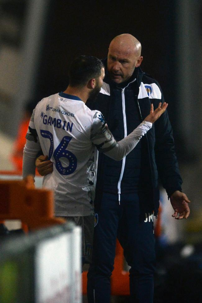 Discussion - substitute Luke Gambin chats to Colchester United boss John McGreal after being taken off following Ryan Jackson's red card Picture: RICHARD BLAXALL