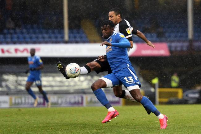 Focused - Colchester United striker Theo Robinson does battle with Leon Legge of Port Vale at Vale Park Picture: RICHARD BLAXALL