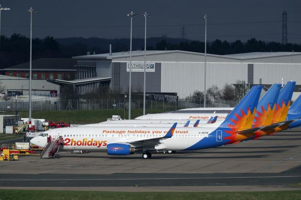 Halstead Gazette: AIRLINE: Several Jet2 planes have been parked up at Birmingham Airport during the pandemic. Picture: Steve Parsons/PA