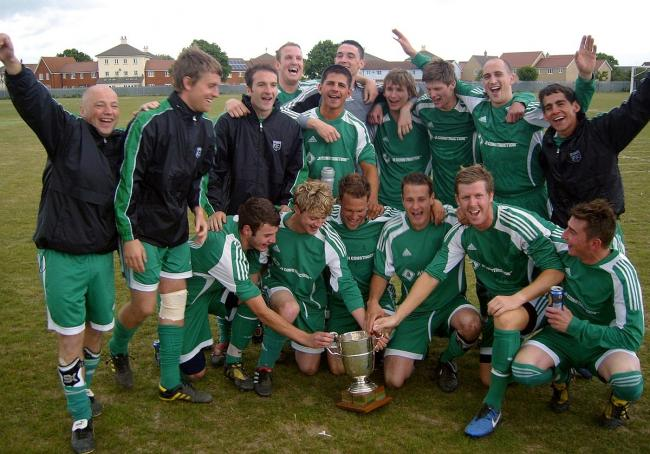 Happy days - Tollesbury celebrate their maiden Colchester and East Essex League title win, in 2011