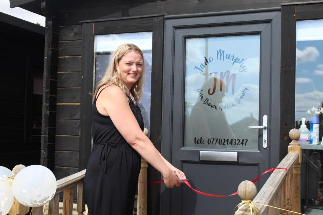 Grand opening: Jade Murphy cuts the ribbon at her new hair salon
