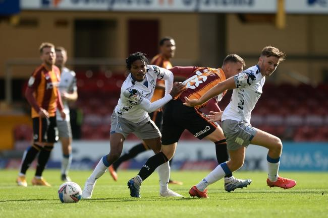 Noah Chilvers of Colchester United and Jevani Brown of Colchester United does battle with Elliot Watt of Bradford City - Bradford City vs. Colchester United - Sky Bet League Two - Valley Parade, Bradford - 12/09/2020 - Photo: Richard Blaxall