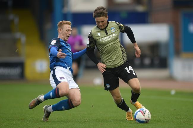 In possession - Colchester United's Noah Chilvers looks to get past Callum Guy of Carlisle United Picture: RICHARD BLAXALL