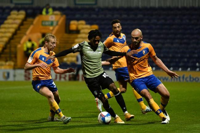 Crowded out - Colchester United forward Jevani Brown does battle with Farrend Rawson and Malvind Benning of Mansfield Town during the 1-1 draw at the One Call Stadium Picture: RICHARD BLAXALL
