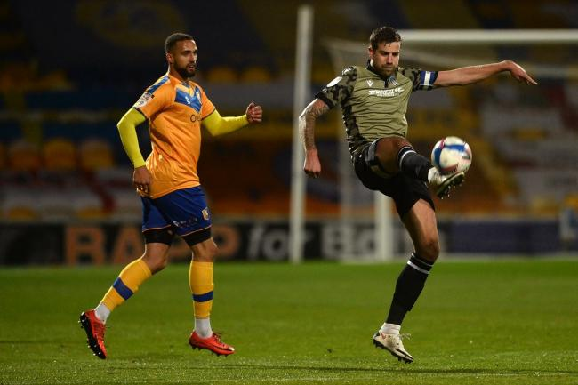 Leg up - Colchester United skipper Harry Pell in action at Mansfield Town, on Friday night Picture: RICHARD BLAXALL