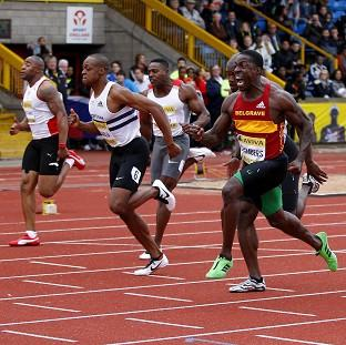 Dwain Chambers (right) claimed victory in the 100 metres at the trials in Birmingham