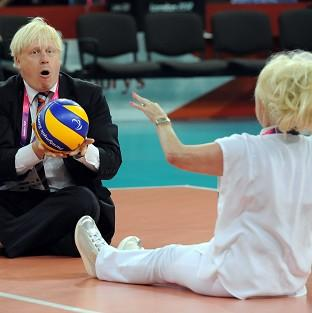 Mayor of London Boris Johnson, left, and actress Barbara Windsor enjoy a game of sitting volleyball