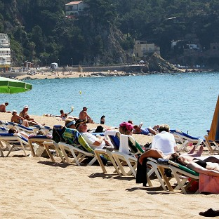 A man and a boy have drowned off the coast of Majorca, the Foreign Office says