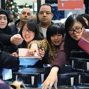 Shoppers scramble for perfume in Selfridges department store in London's Oxford Street - while millions of others shop online