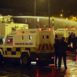 Police use water cannon in Belfast to disperse loyalists in the ongoing Union flag protests