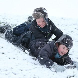 Daniel and James Egerton play on their sledge in Bingham, Nottinghamshire