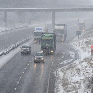Traffic on a snowy M42 motorway in Derbyshire