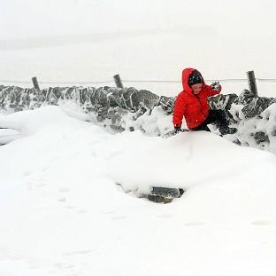 A six-year-old boy enjoys playing in the snow on the Northumberland border