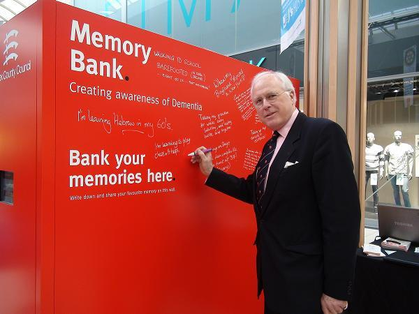 County councillor John Aldridge writing his memory on the memory bank