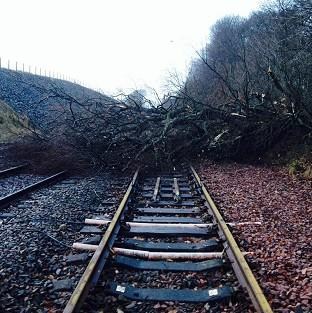 Road and rail travellers faced more misery as storms continue to batt