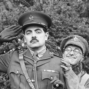 Tony Robinson as Private Baldrick, right, with Rowan Atkinson as Captain Edmund Blackadder in the series of Blackadder set during the First World War