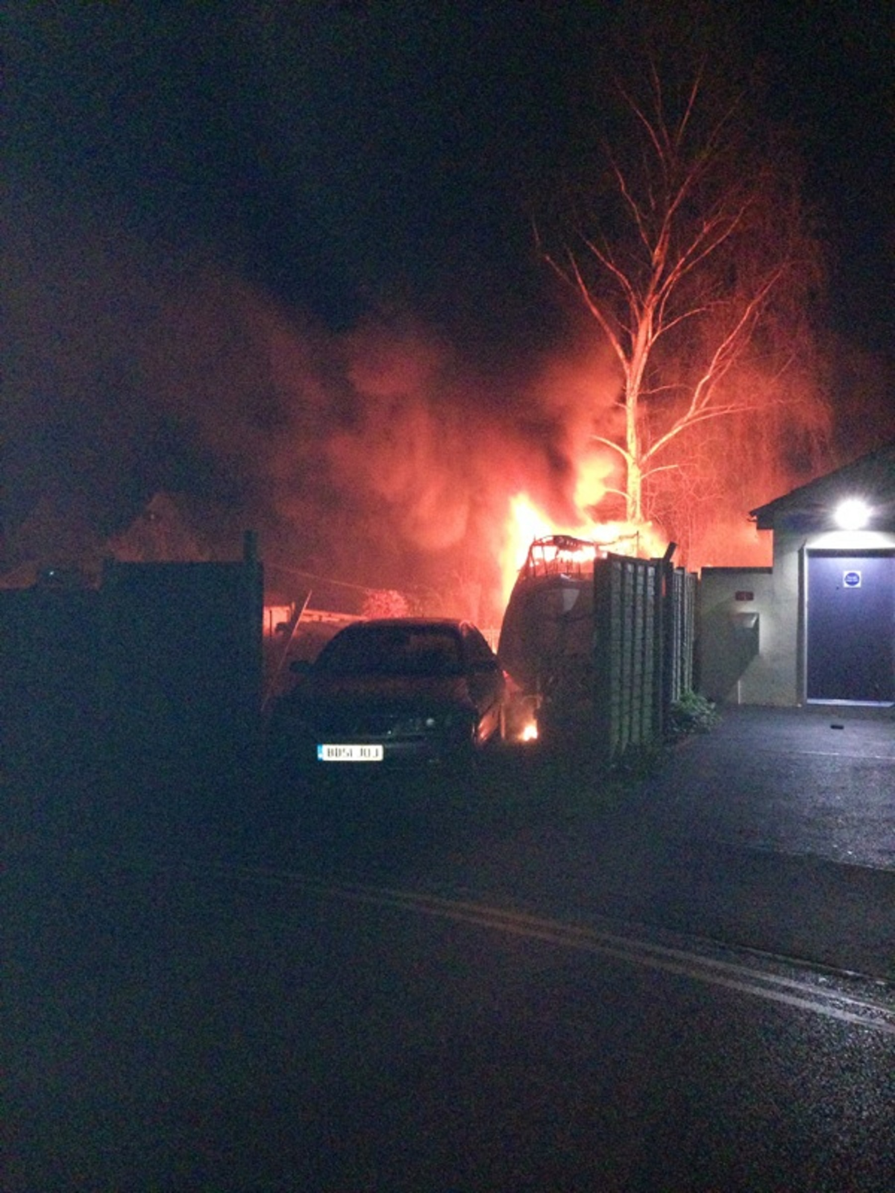 Flames engulf boat which caught alight in garden