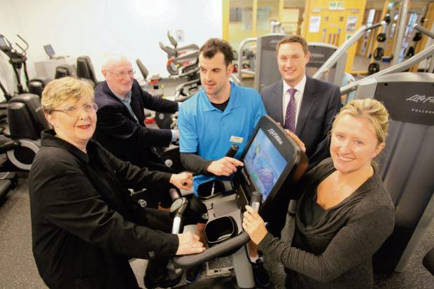 Councillors Jennie Sutton and Peter Tattersley with Lisa Costa and Mark Johnson getting training tips from personal instructor Ed Willett about how to use the new training screens at the newly refurbished Halstead Leisure Centre