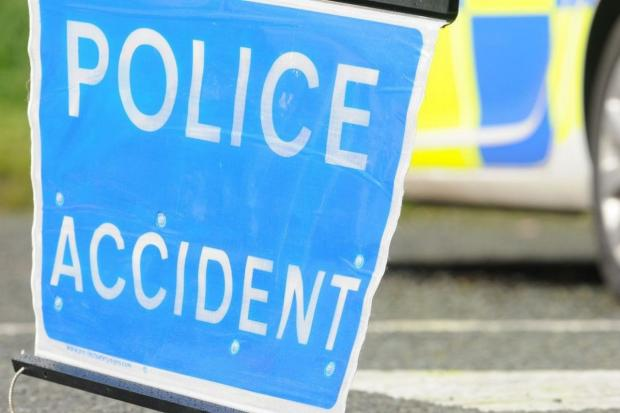 Man cut from car following crash