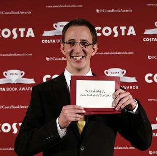 Halstead Gazette: Nathan Filer accepts the 2014 Costa Book Award for his novel 'The Shock of the Fall' at Quaglino's, London.