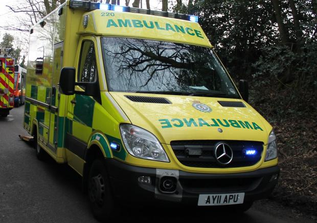 Driver taken to hospital after car overturns