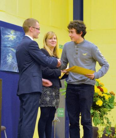 Luke Evans is presented with his award by Dr Nicholas Oettle
