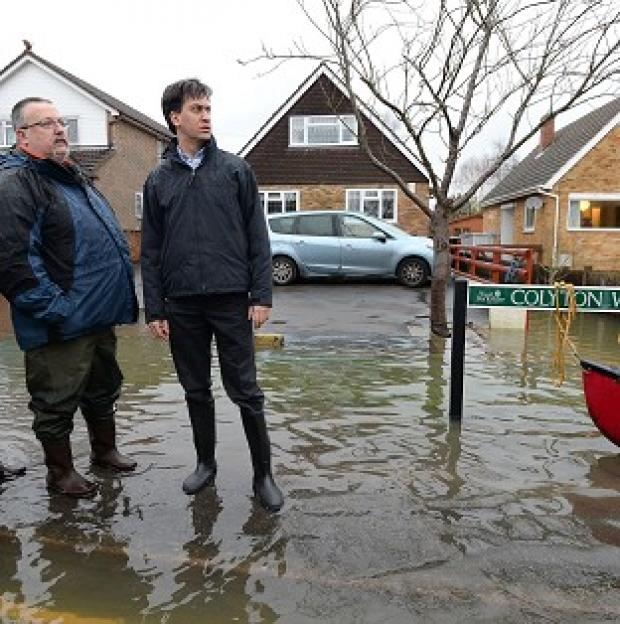 "Halstead Gazette: Ed Miliband has attacked David Cameron for giving up the fight against climate change and said the winter storms should serve as a ""wake-up call"""