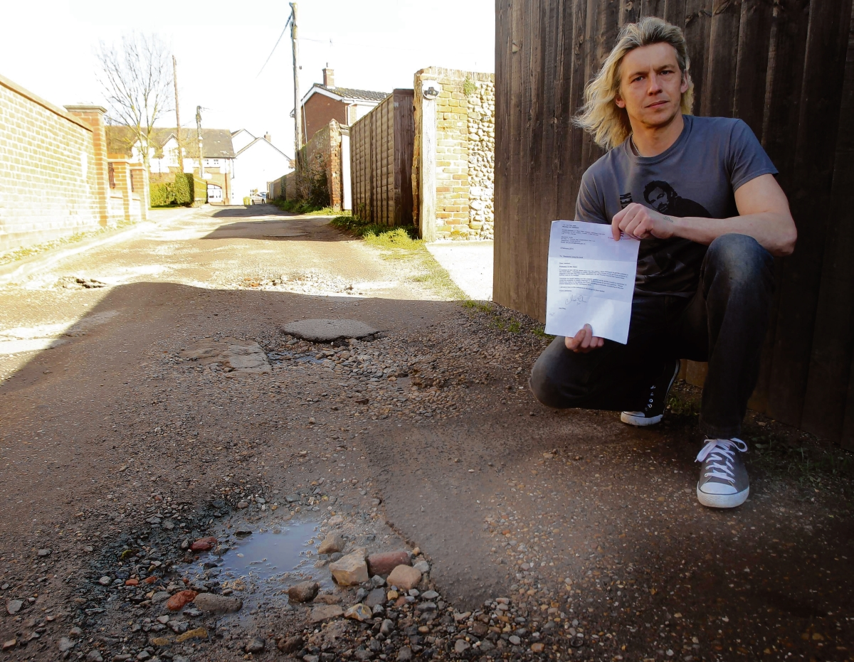 Council insists it is not responsible for maintainance of track behind homes