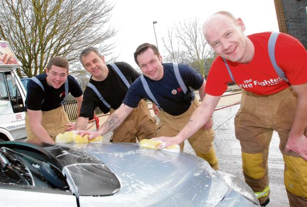 Firefighters scrub up well at charity car wash