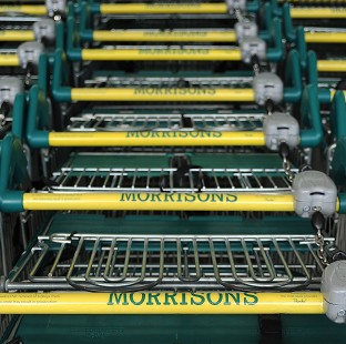 Morrisons has posted an annual loss of �176 million