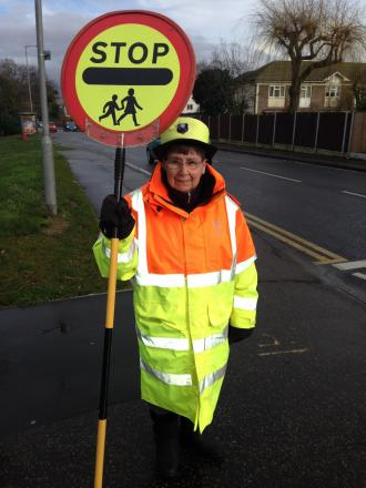 A lollipop lady at Cherry Tree Primary School