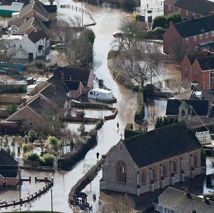 Halstead Gazette: Flooded properties in the village of Moorland on the Somerset Levels