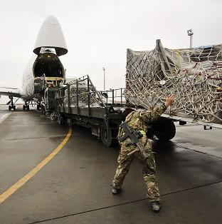 Equipment being loaded into a Boeing 747 headed for the UK after being recovered fro