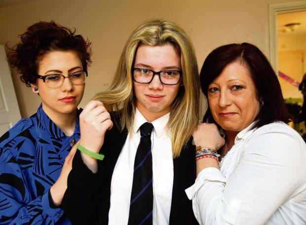 Sian Lawrence,15 with her mum, Jane and sister Danielle,18.