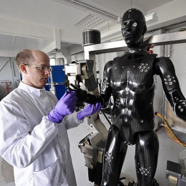 Halstead Gazette: Jaime Cummins checks the Porton Man robot mannequin that will help test the next generation of chemical and biological suits for the UK's armed forces
